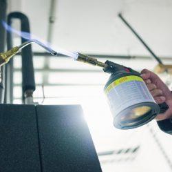 bauen Minol-Legionellenpruefung-Desinfizierung-der-Entnahmestelle